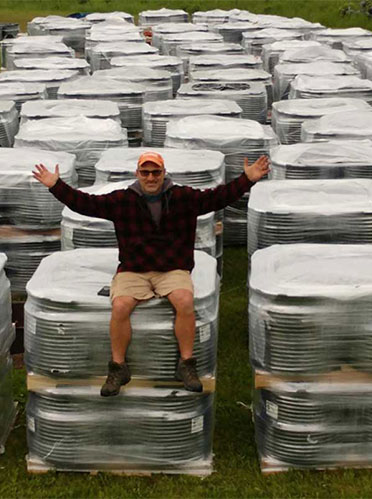John Tucci of Everblue Lakes with 380 coils of tubes, each 500 feet.