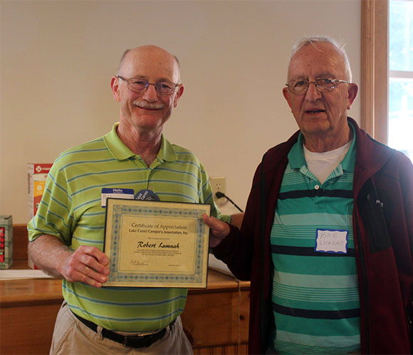 President Beneven thanks & honors director Robert Lumnah - Larry Myott Photo